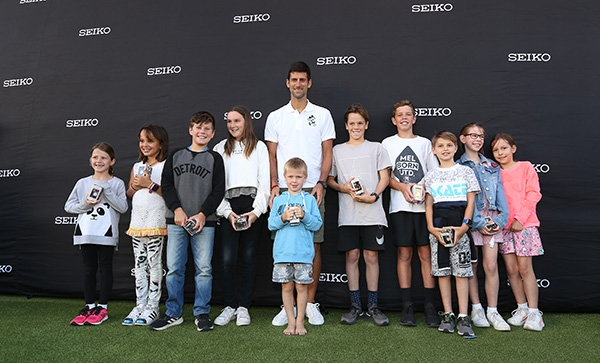 Photo of Novak with participants of the event