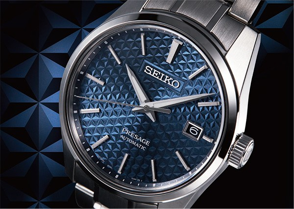 An intricate Asanoha pattern decorates the dial.